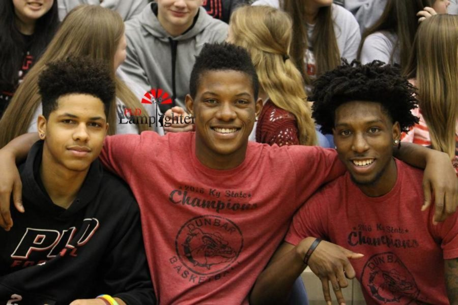 Seniors Isaiah Yeast, Dontell Brown, and Taveion Hollingsworth pose together during the rally.
