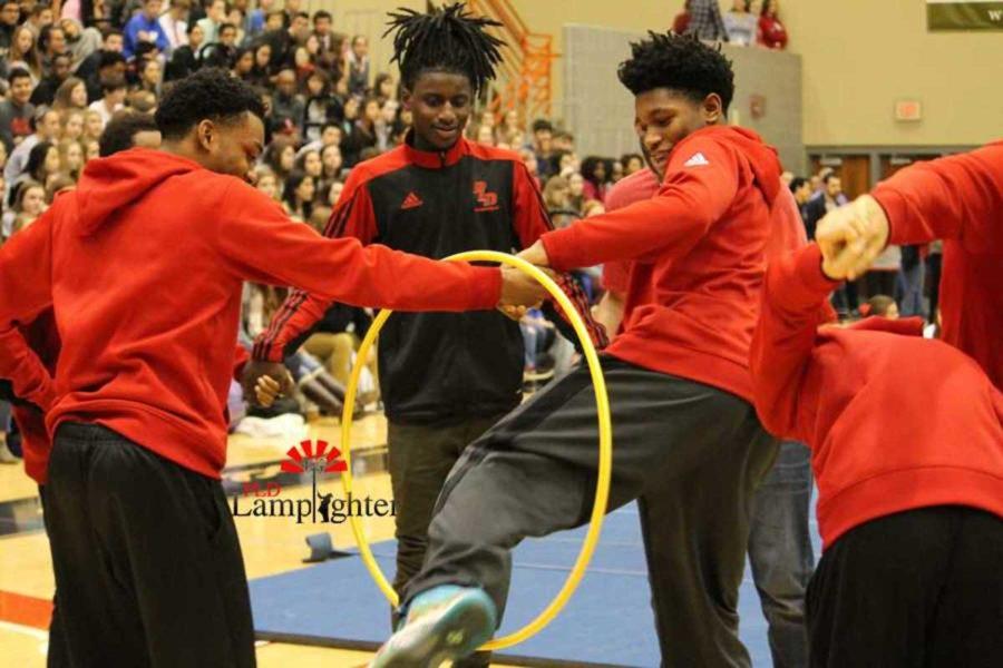 Dunbar Basketball Players participate in the team Hoola Hoop challenge.