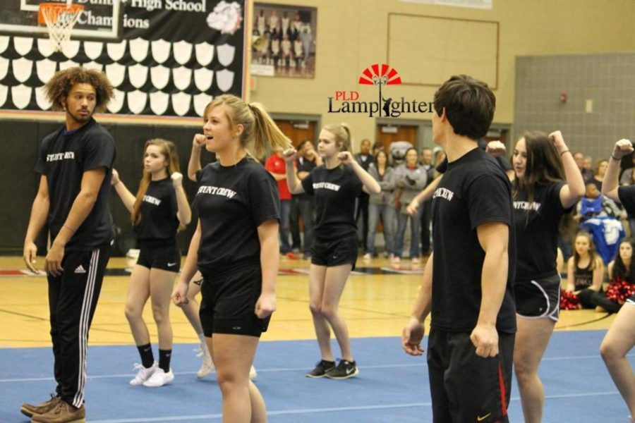 Senior Kallie Hellard performs with the cast of Bring It On during the pep rally.