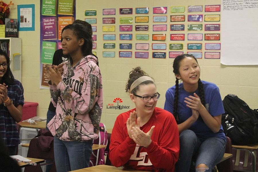 Seniors Murphy Powell and Grace Kelly applaud after a karaoke performance in Mrs. Burns' room after school.