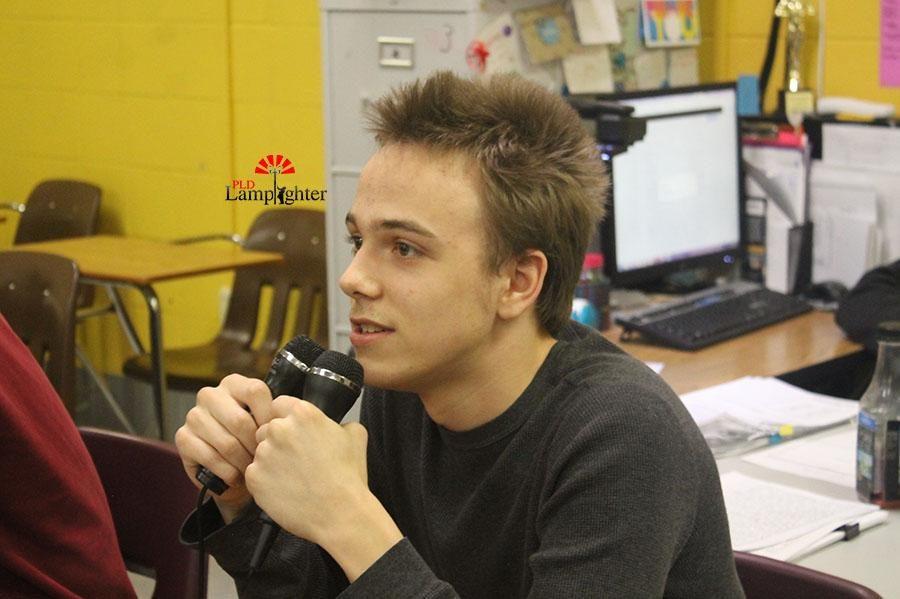 Senior Robert Graham sings All Star during Karaoke Club in Mrs. Burns room after school.