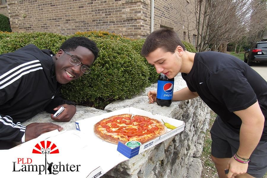Seniors Gbutue Vorkpor (left) and Mike Rosen (right) love their pepperoni pizza.