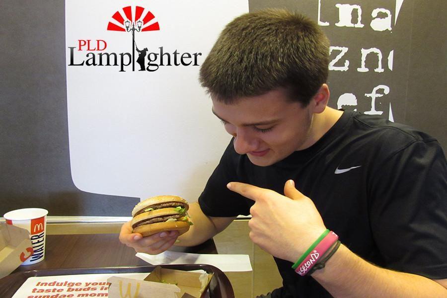 Senior Mike Rosen eats his first ever Big Mac.