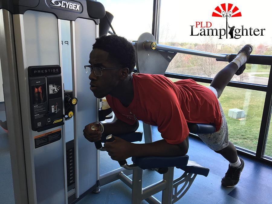 Senior Gbutue Vorkpor works on his legs after cycling classes on Tuesdays.