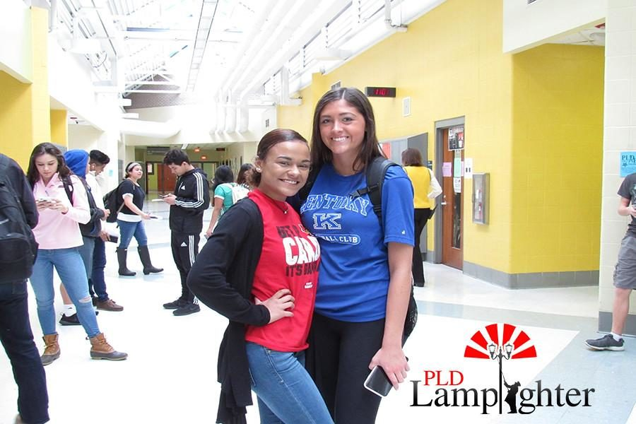 Senior Alexis Logan (left) and Hannah Lucas (right) wear rivals University of Louisville and University of Kentucky shirts.