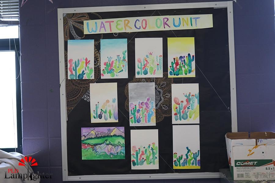 Student watercolor pieces are showcased in Mrs. Pawleys classroom.