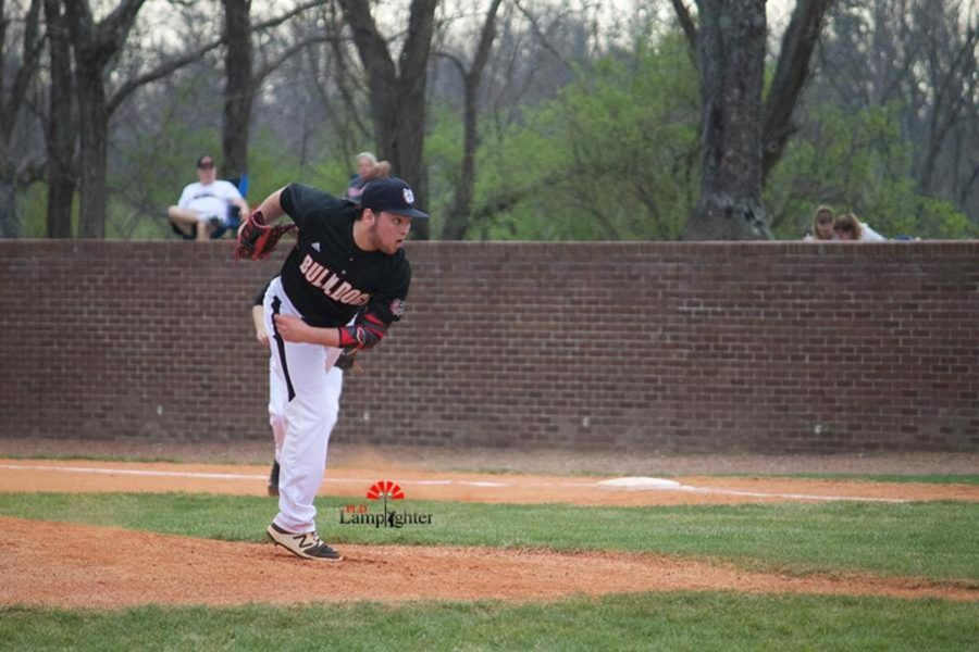 Sophomore Cameron Baughman pitching the ball.