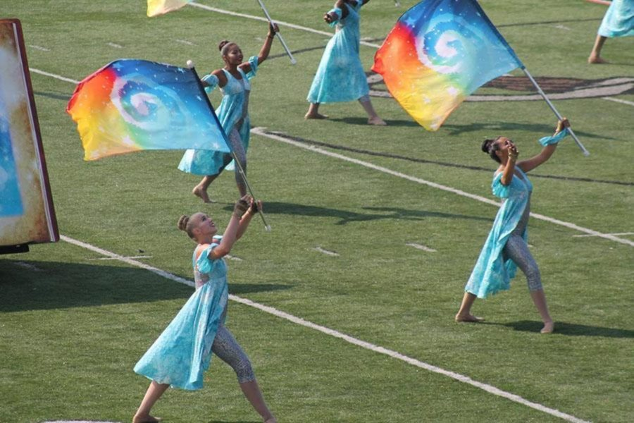 The Color Guard performs their routine.