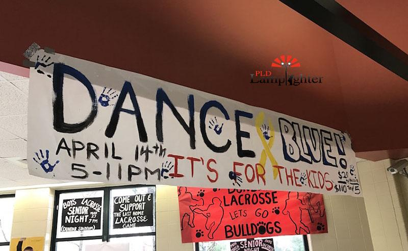 A student-made banner advertising Dance Blue which hangs in the main entrance of Dunbar.