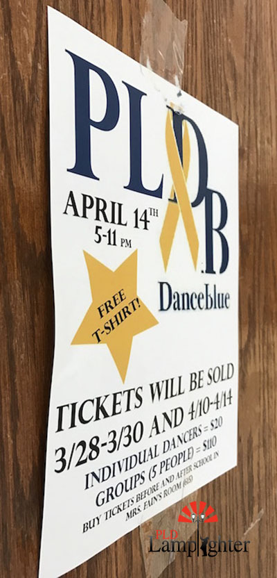 A student-made Dance Blue flyer hanging in one of Dunbars hallways.