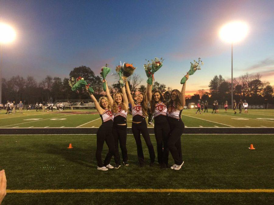 The dance team seniors (Taylor Kemper, Jordan Scholl, Elise Cammack, Josie Geoghegan, Rebecca Pollack) on Senior Night after receiving their bouquets.