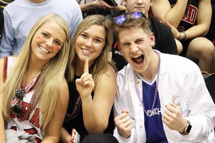 Seniors Madison Calhoon, Amy Holbrook, and Will Cornelius get hype during the pep rally.
