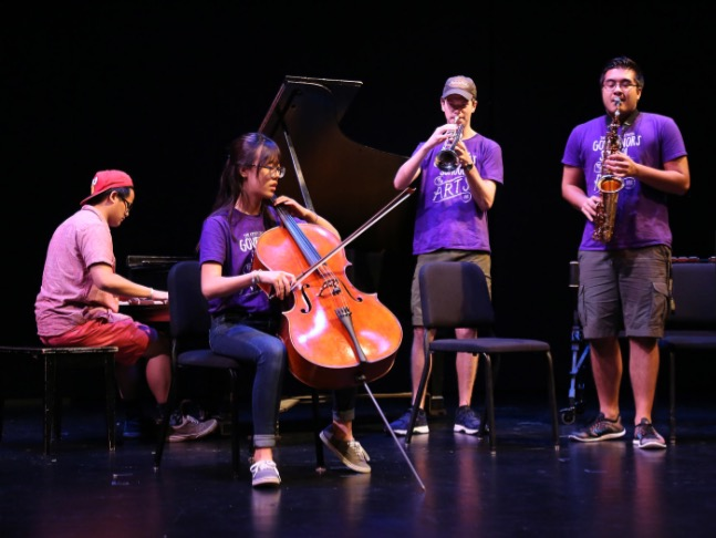 Junior Jin Cho playing cello with other instrumental music students at the Governor's School for the Arts program.