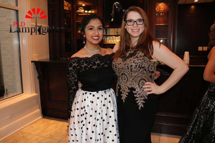 Seniors Deebha Adhikari and Samantha Cooper posed at prom.