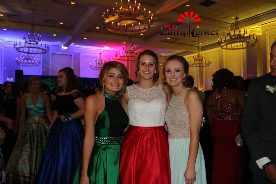 Seniors Brooke Bledsoe, Hope Vain and Klaire Johnson pose at prom.
