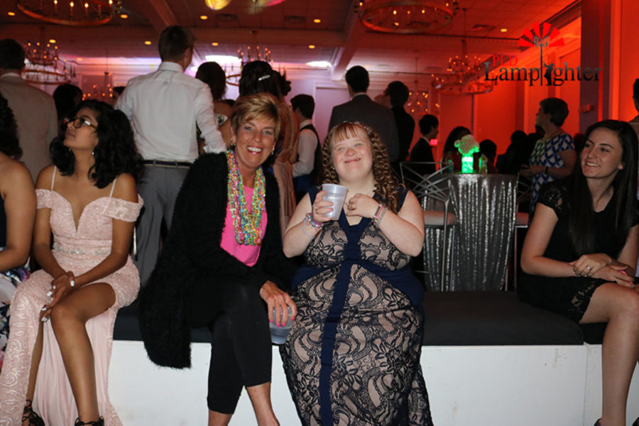 Mrs. Robin Flannery and Mallory Hughes enjoying prom.