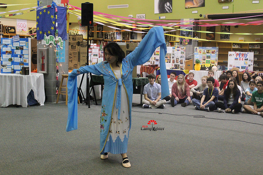 Sophomore Eleanor Liu performs a traditional Chinese long sleeve dance during the cultural fair on April 12.