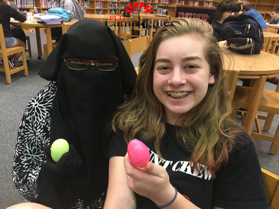 Freshmen Rehma Ashraf and Jaycee Castro wear wide smiles after finding eggs in the library.