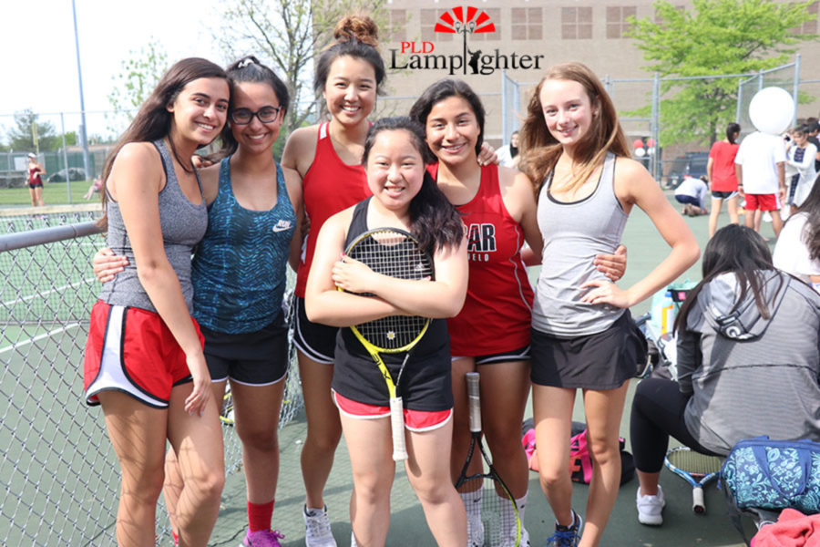 A+group+of+Dunbar+girls+tennis+players+gather+for+a+group+photo.