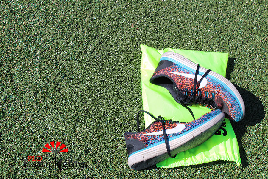 A pair of track shoes and a bag used for practice.