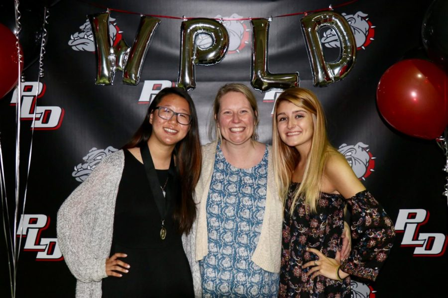 Editors-in-Chief Emily Liu and Brooke Bledsoe with Lamplighter advisor Wendy Turner