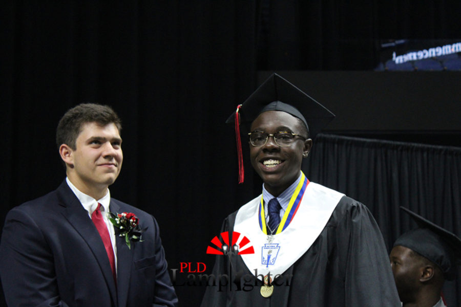 Dennis Mashindi smiles as he waits to go across the stage.