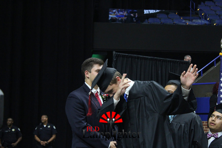 Graduate Graham Orschell dabs before his walk across the stage.