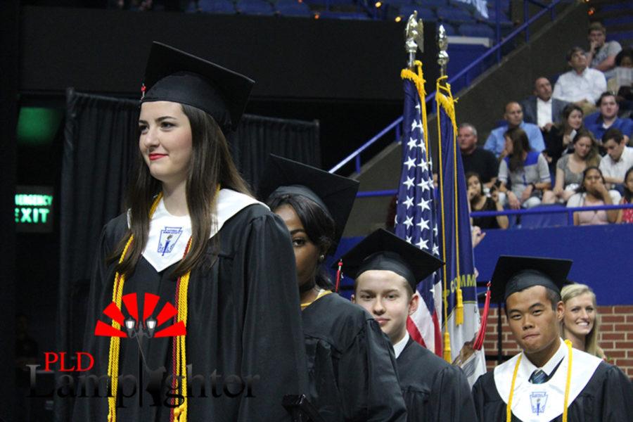 Kamryn Stewart waits to get her diploma.