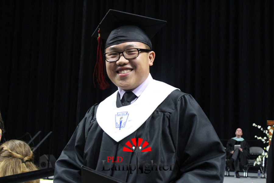 Bryant Tang smiles after receiving his diploma.