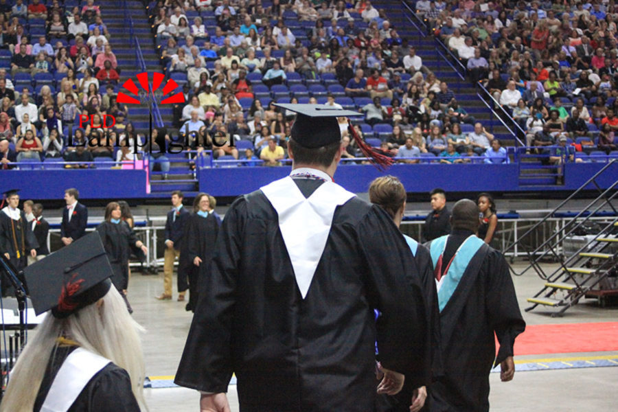 Ryan Kennedy leads the way towards the stage during the graduates precession.