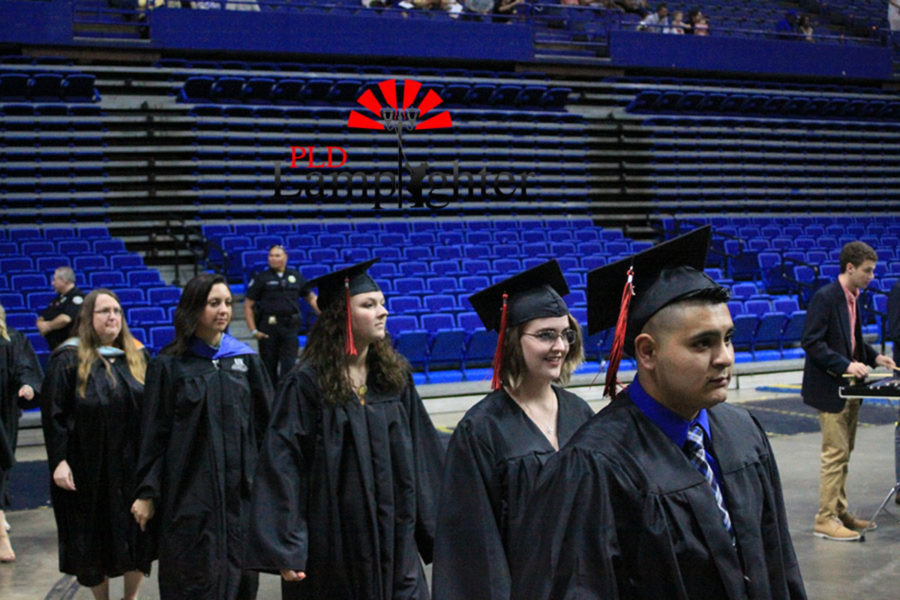 Graduates make their way to their seats during the precession.