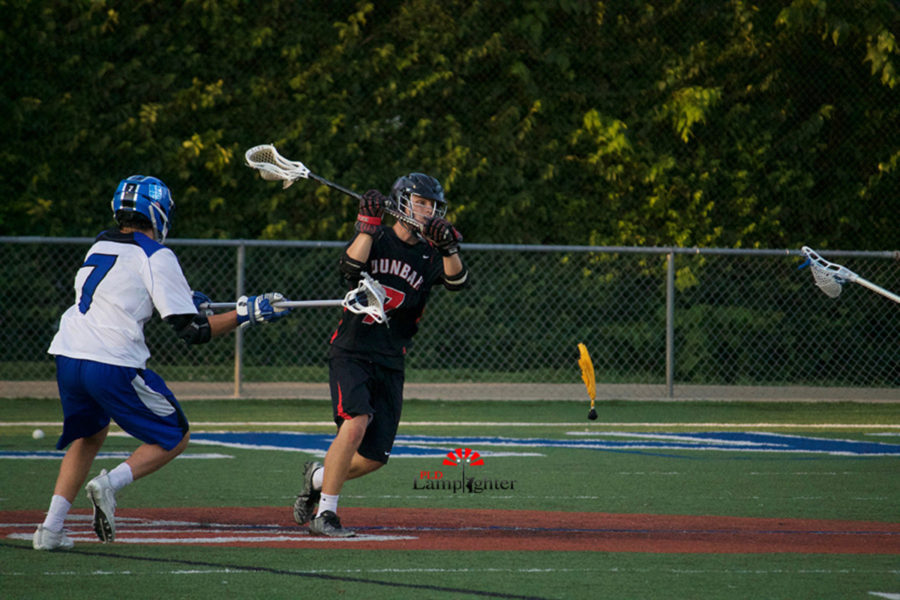 Senior Zach Helmberg (#7) passes the ball.