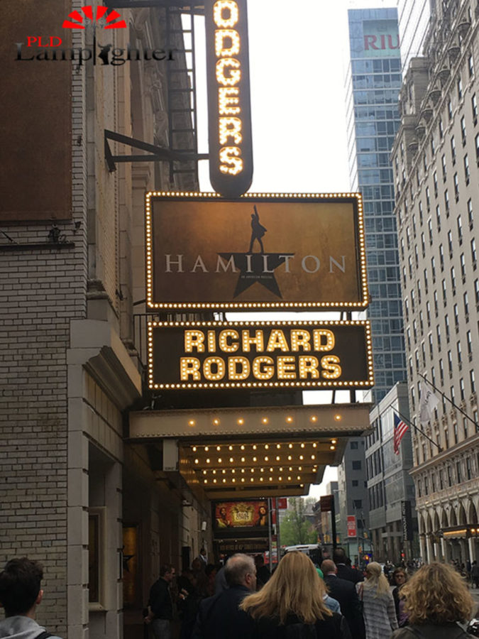 While street-walking they passed the Broadway poster for Hamilton.