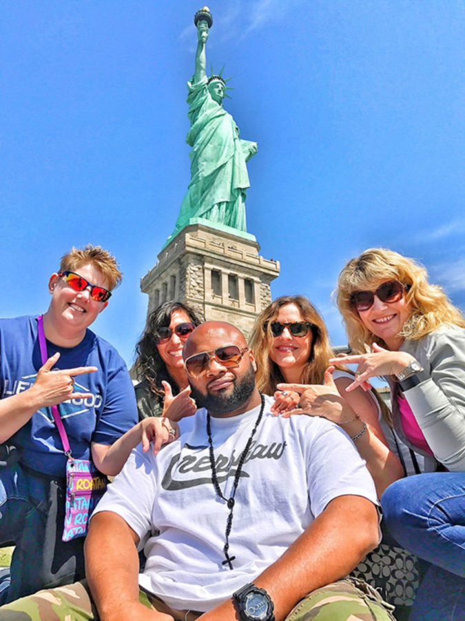 Senior Trip Chaperones from left to right: Ms. Doring, Ms. Reaguer, Mrs. Martin, Ms. Montgomery, and Mr. Harris pose for a photo in front of the Statue of Liberty.