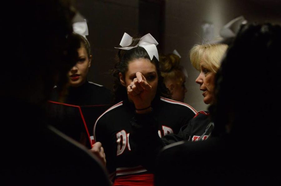 Cheer Coach Donna Martin giving the girls a pep talk before showtime.