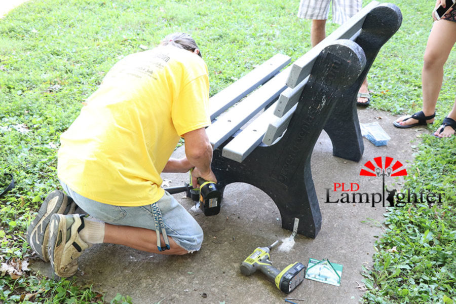 Jerome Higginbotham installing the bottle cap bench.
