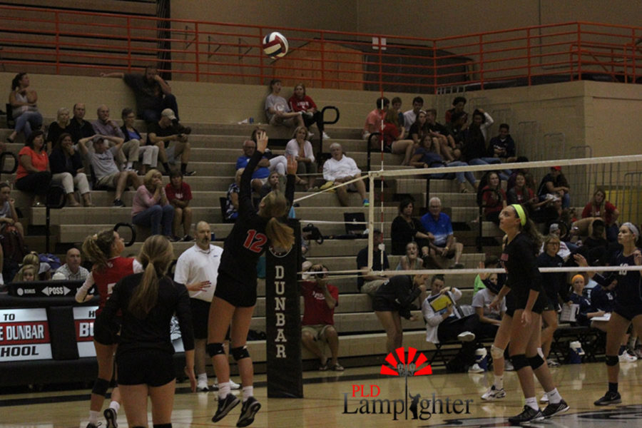 Junior Meredith Phillips saves the play with good hustle assists.