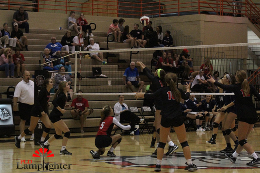 Sophomore Eleanor Davis (9) saves the play by sending over a free ball.