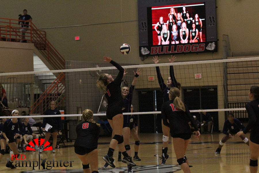 Freshman Kaetlin Ethington sees a hole in the block and goes for a big attack.