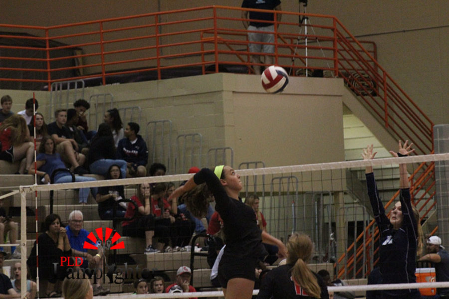 Sophomore Eleanor Davis explodes in for a kill from the middle.