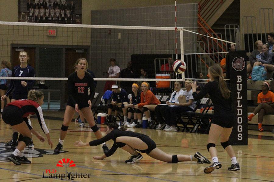 Senior Hannah Tucker makes a great hustle play to save the ball.