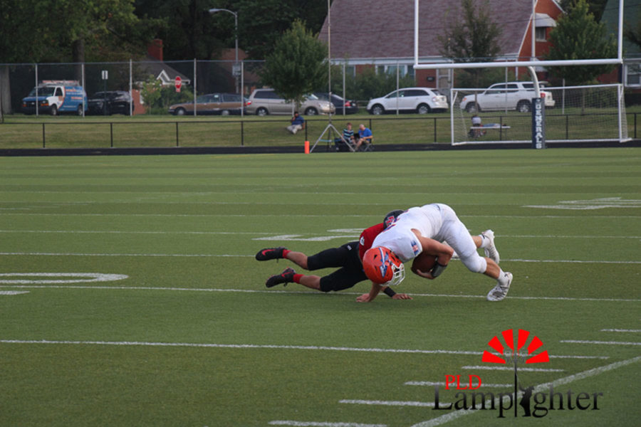 #17 Tyler Johnson makes a tackle.