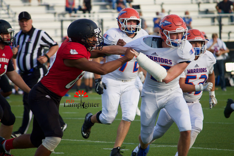#69 Nathan Guettler attempts to block an opposing defender.