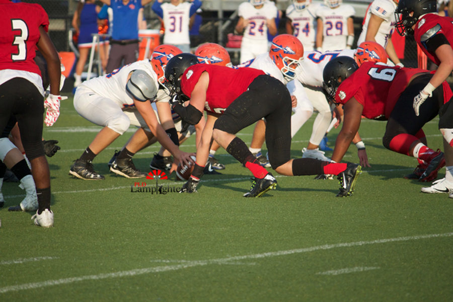 The Dunbar defense prepares for the ball to be snapped.