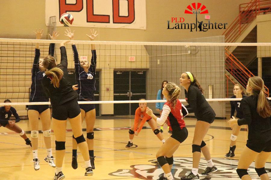 Senior Virginia Smith (17) makes a strong attack over the block.