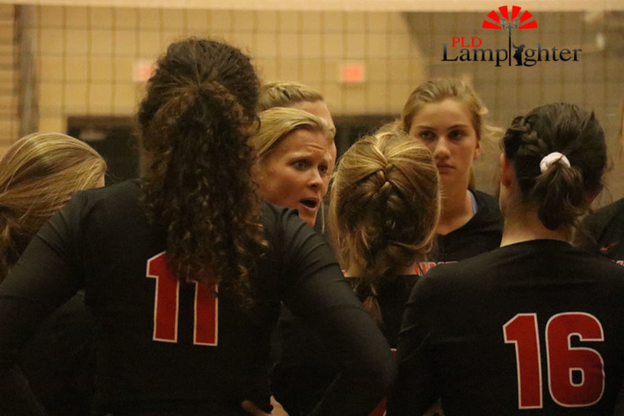Head coach Jenni Morgan meets with the team.