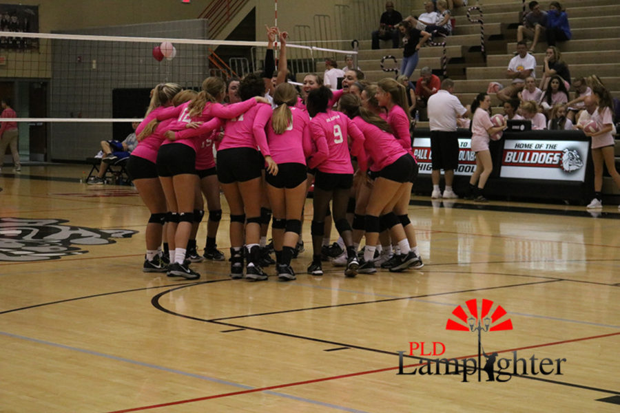 The team huddles together as they prepare to play Lafayette in the Cancer Classic.