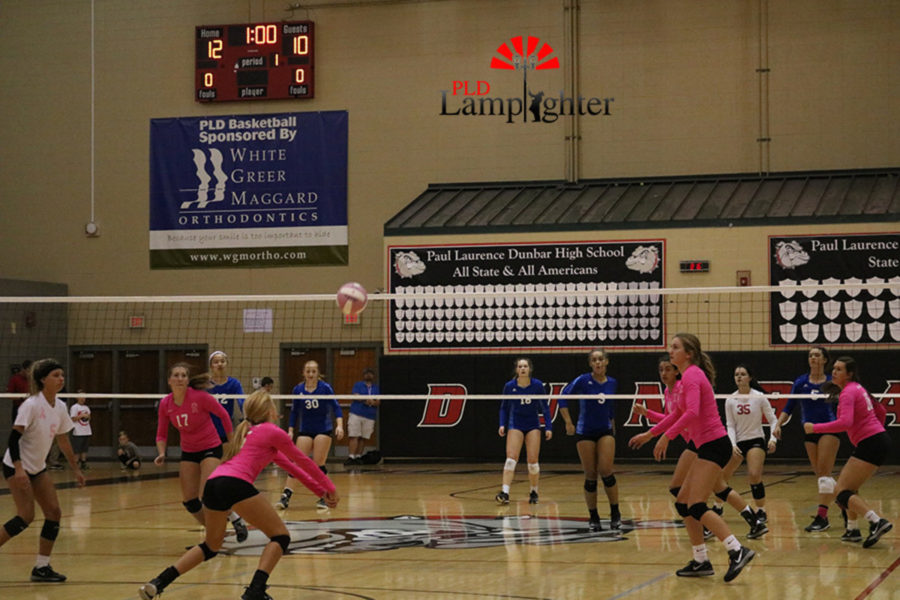 #15 Sophomore, Olivia Stotz sets up the play with a pass to setter, #12 Meredith Phillips.