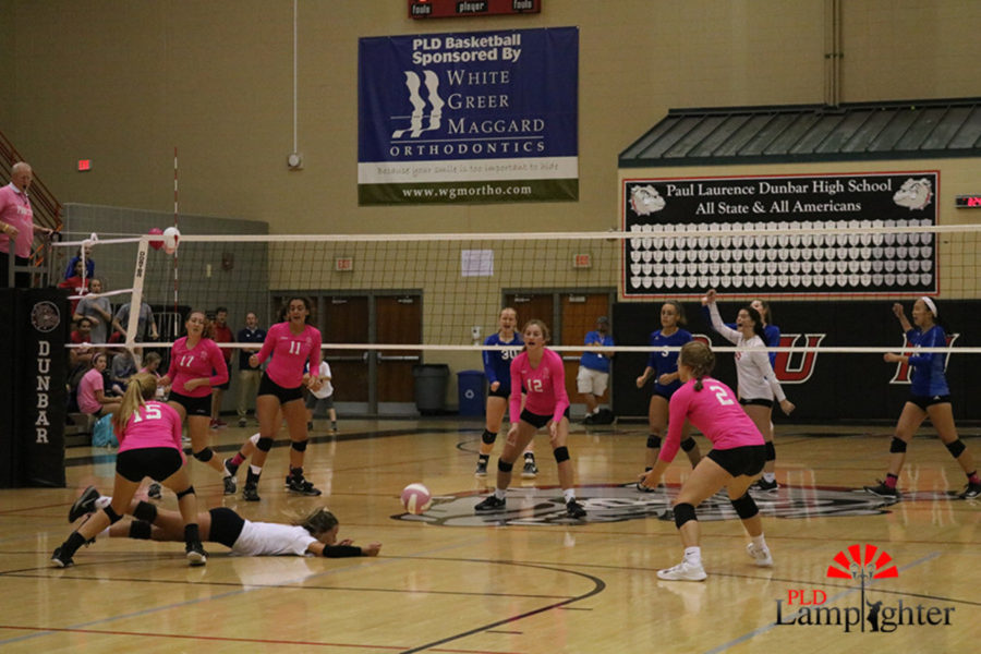 #5 Senior, libero, Allie Chapman dives to keep the ball in play.
