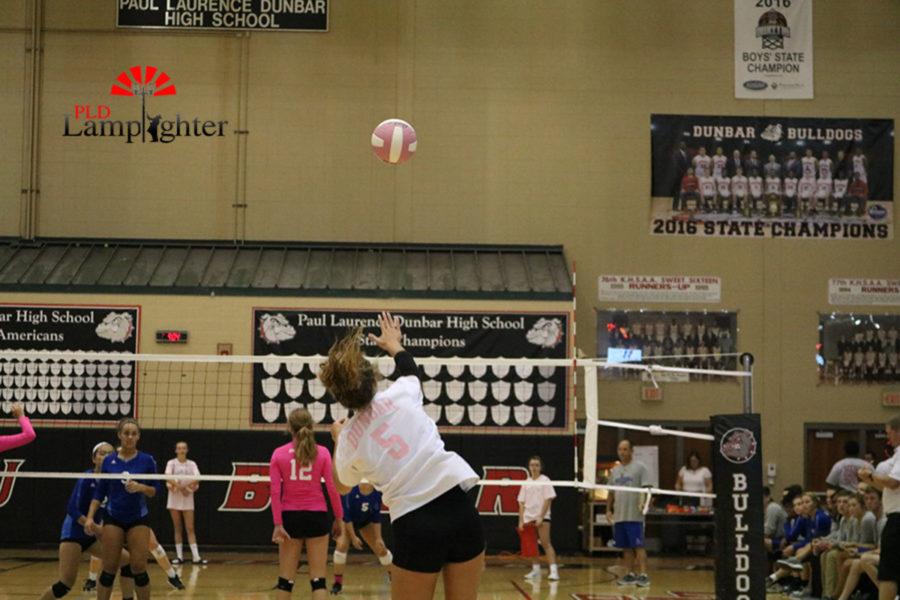#5 Senior, Allie Chapman makes an aggressive serve over the net.